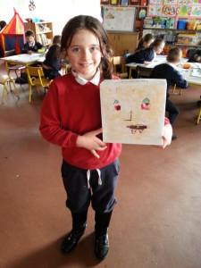 Ellen McDonagh recycles a cardboard box.